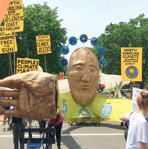Carolina Climate Justice with banners and face